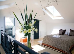The Studio - A spiral staircase leads up to a light and airy bedroom with a king size bed and en-suite bathroom.