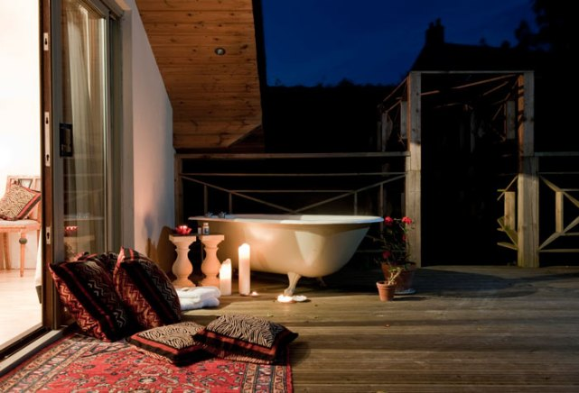 The Studio - The balcony leads onto its own private deck, with a roll top bath overlooking gardens in a secluded part of the grounds, with stunning views over the countryside.