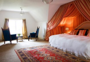 Princess Room - Orange and cream striped draped canopy Super king size bed En-suite with power shower Overlooking the fountain with stunning views Flat screen TV/DVD