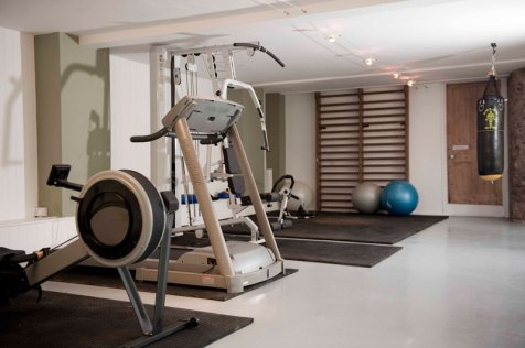 Gym is equipped with weights machine, running machine, rowing machine, medicine balls, gym mats and free weights